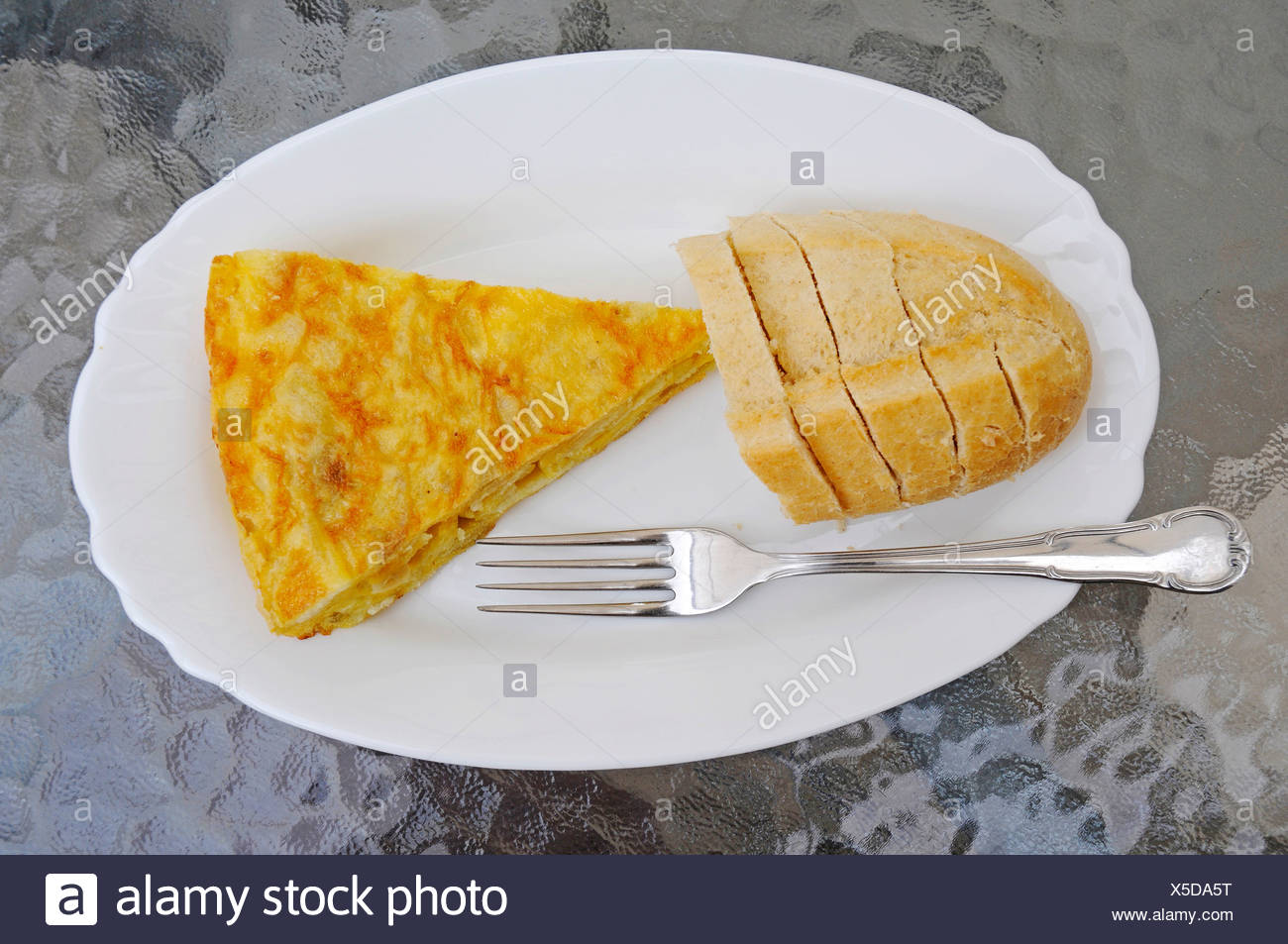 Spanish tortilla, potato dish, bread, plates, forks, Tapas, Javea, Xabia, Costa Blanca, Alicante, Spain, Europe - Stock Image