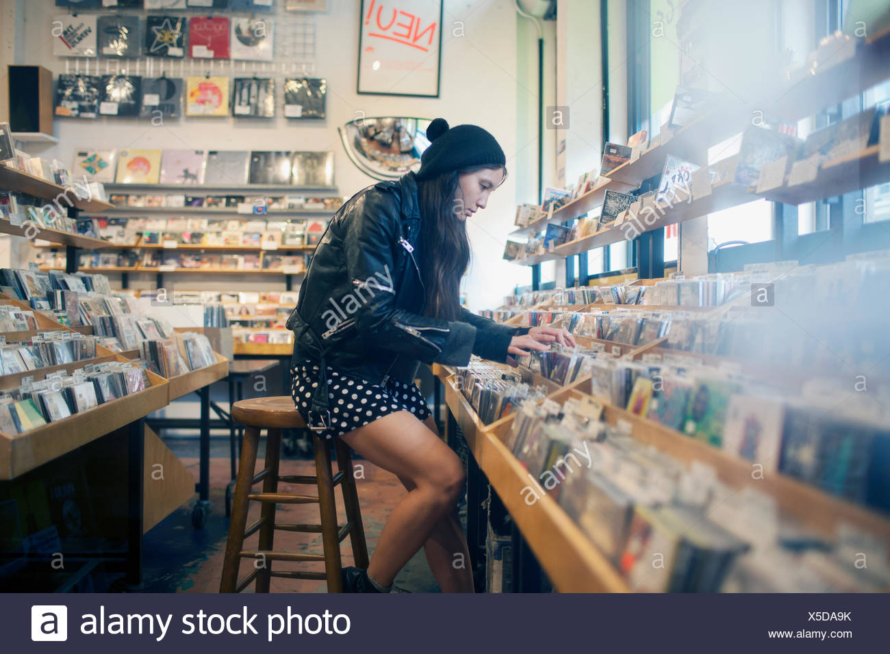 Young woman browsing albums in a record store - Stock Image