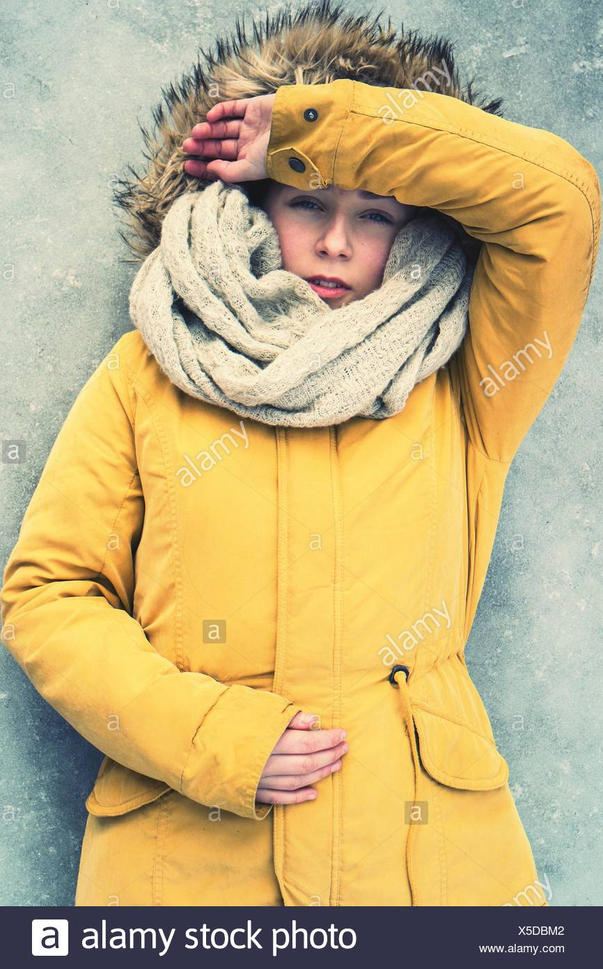 Portrait Of Young Woman In Yellow Jacket - Stock Image