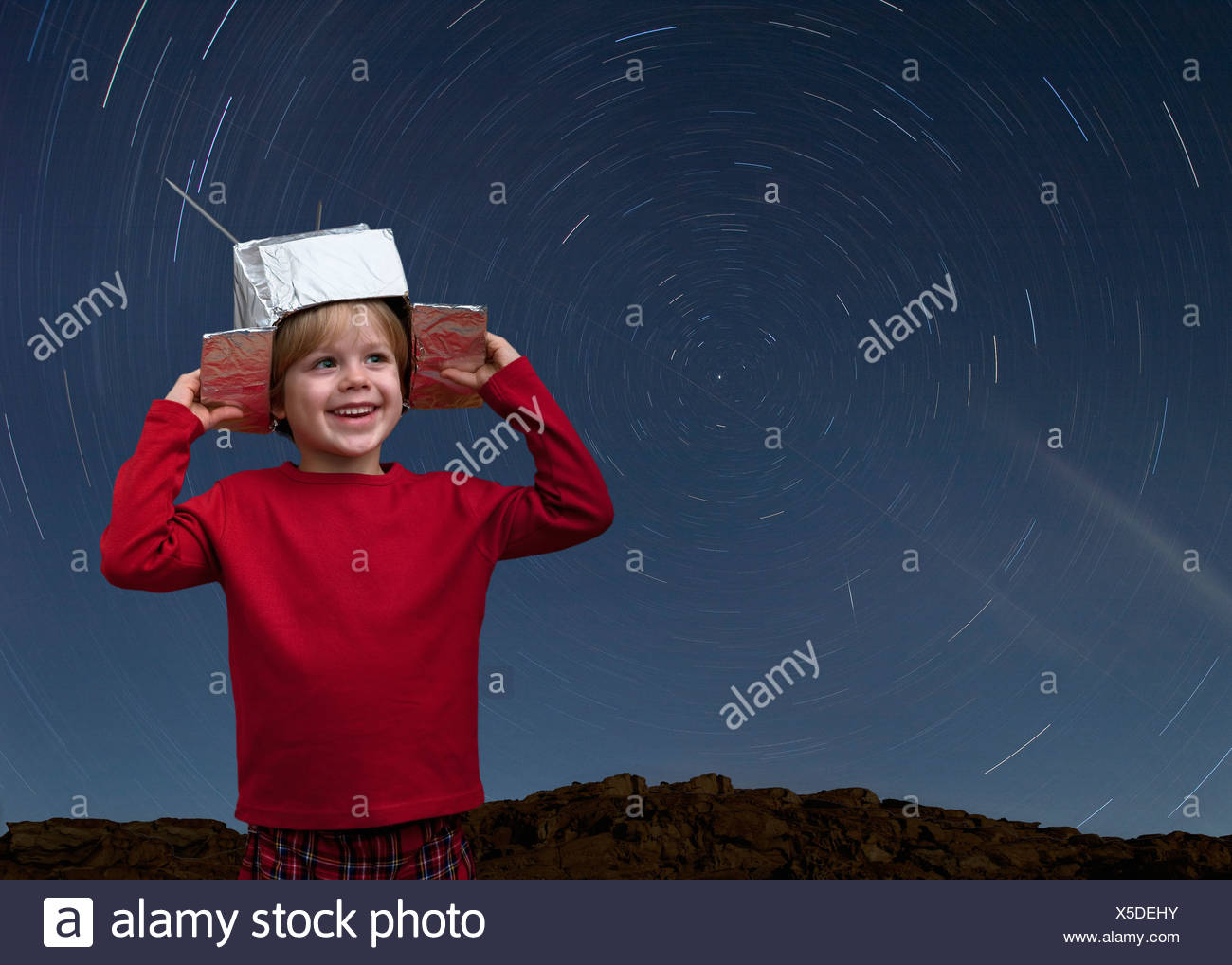 Croatia,Boy with space hat and star trail in the sky - Stock Image