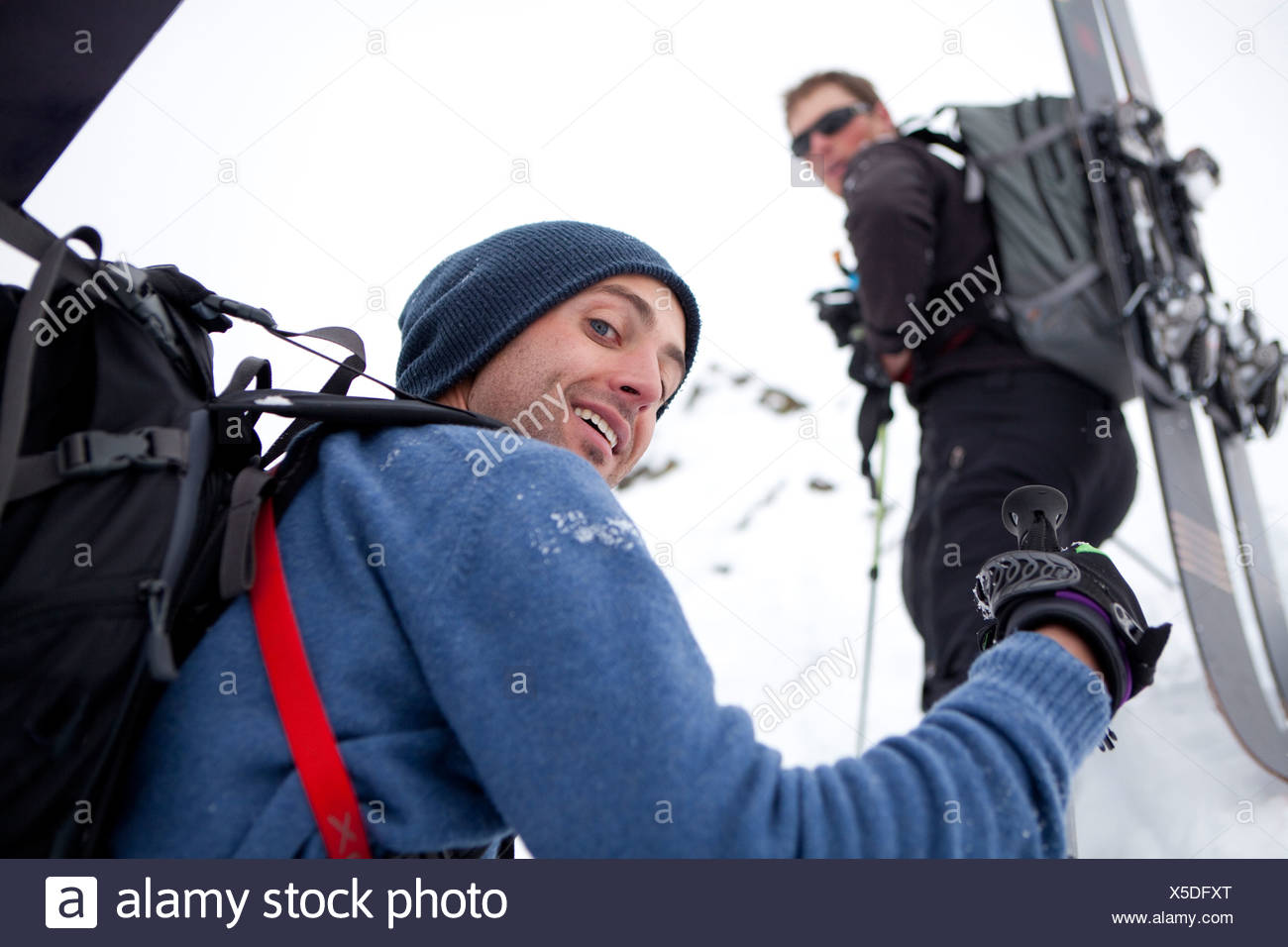 Two men pause for a beak on their way up to the top of Mt Superior, Utah - Stock Image