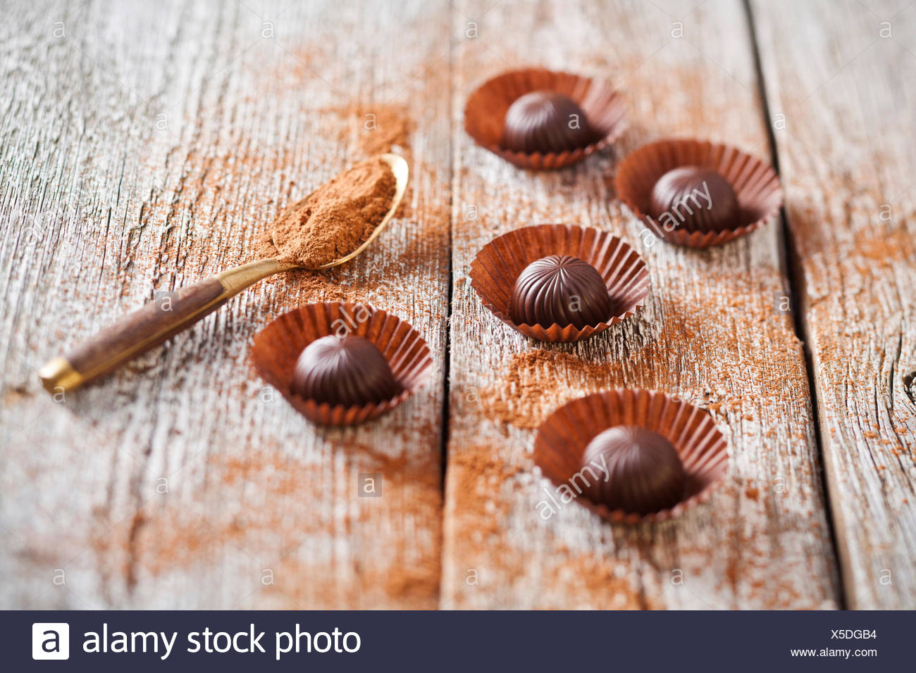 Chocolate candies on wooden background - Stock Image