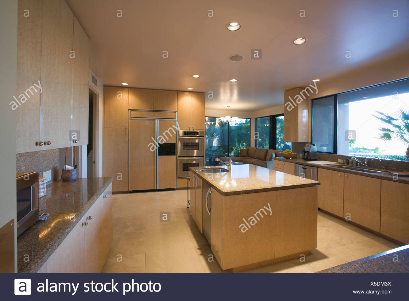 Open plan kitchen in neutral colours, Palm Springs - Stock Image