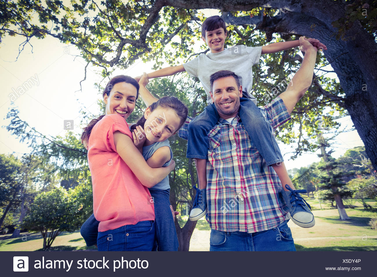 Happy family in the park together - Stock Image