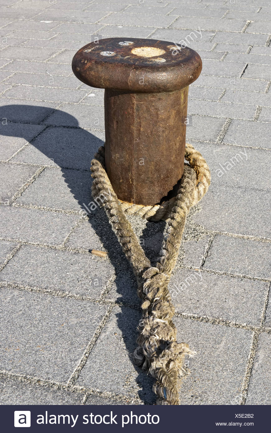 Bollard with rope Stock Photo