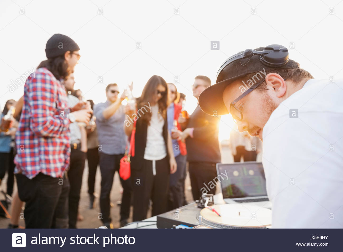 DJ playing music at rooftop party - Stock Image