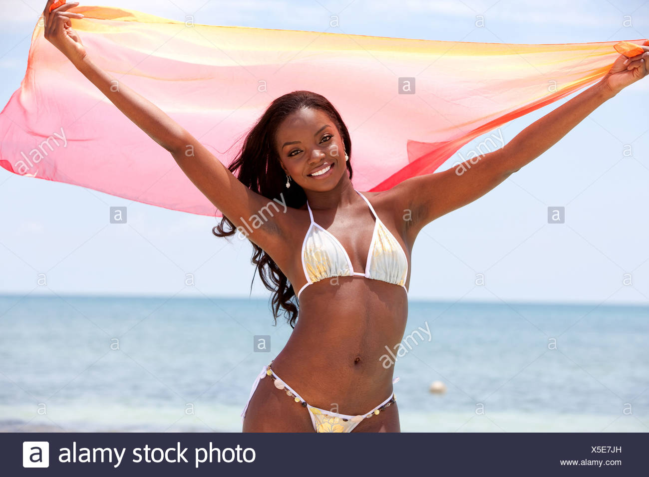 4c8297fa2c5ec beautiful black bikini woman having fun at the beach