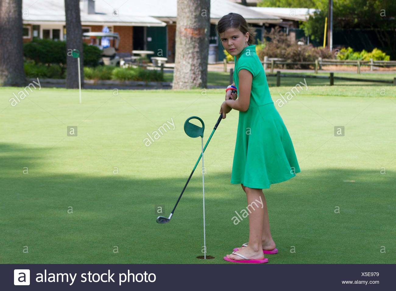 girl playing golf driving range stock photos girl. Black Bedroom Furniture Sets. Home Design Ideas