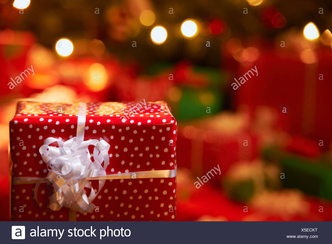 Close up of wrapped Christmas gift - Stock Image