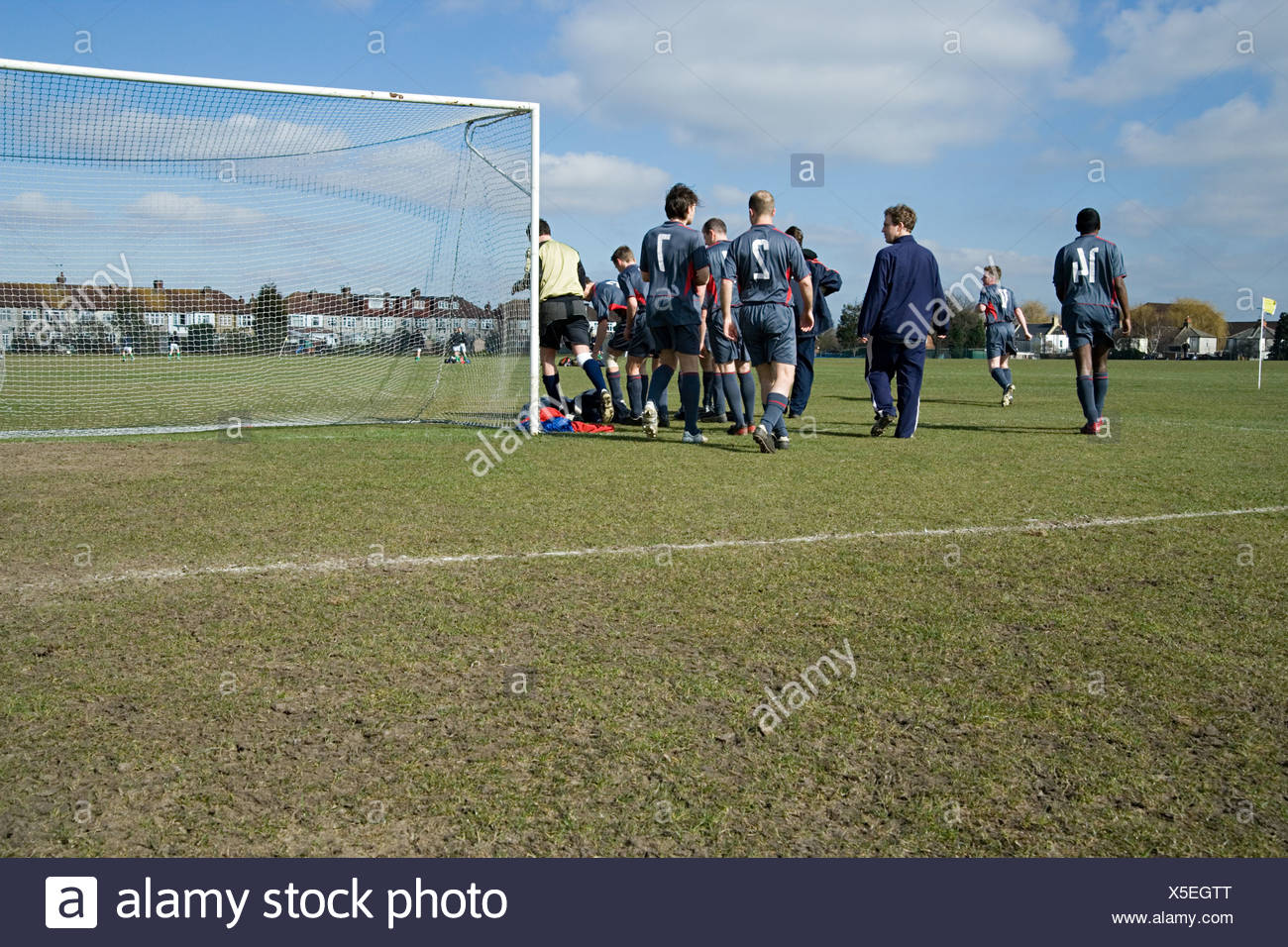Football team leaving pitch - Stock Image