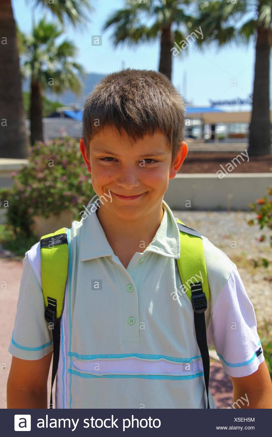 Boy 12 Portrait Wearing A Backpack On A Beach Promenade Mandelieu La Napoule Cote D Azur France Europe Stock Photo Alamy