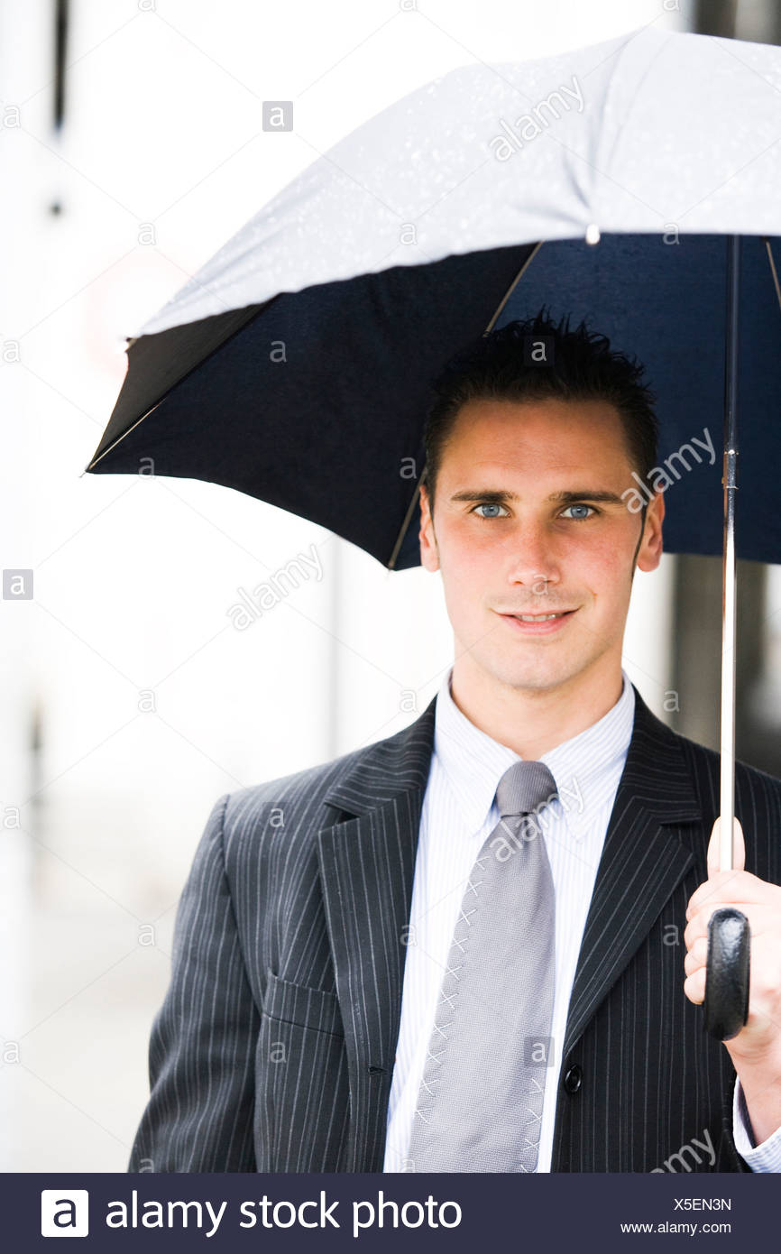 Closeup of man with umbrella - Stock Image