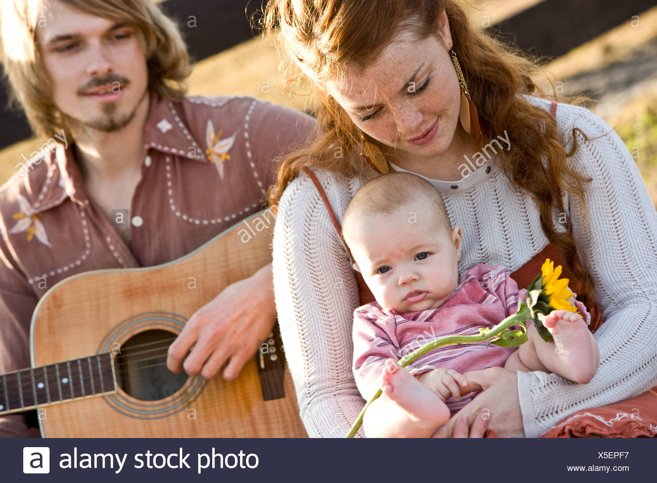 Portrait of young family, 1970s style - Stock Image