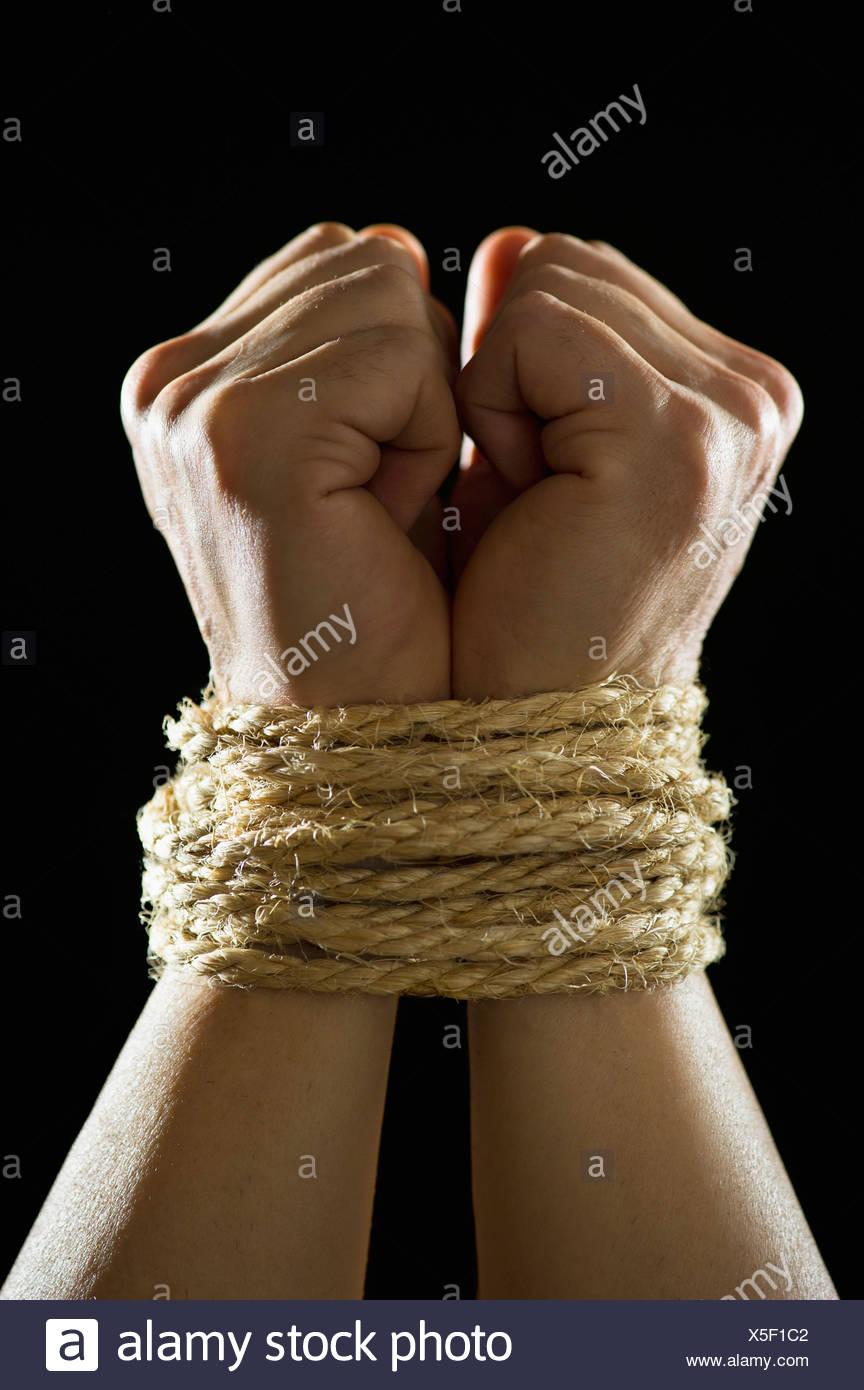 Studio shot of tied hands - Stock Image