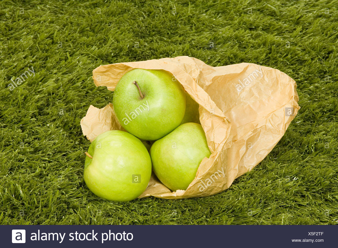 Apples in a paper bag - Stock Image
