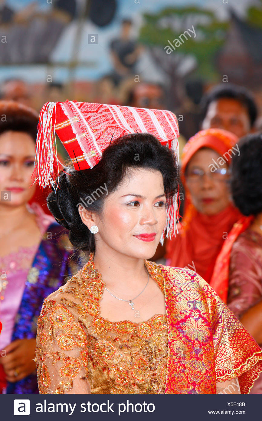 Woman wearing a headdress, guests at a wedding ceremony, Siantar, Batak region, Sumatra, Indonesia, Asia - Stock Image