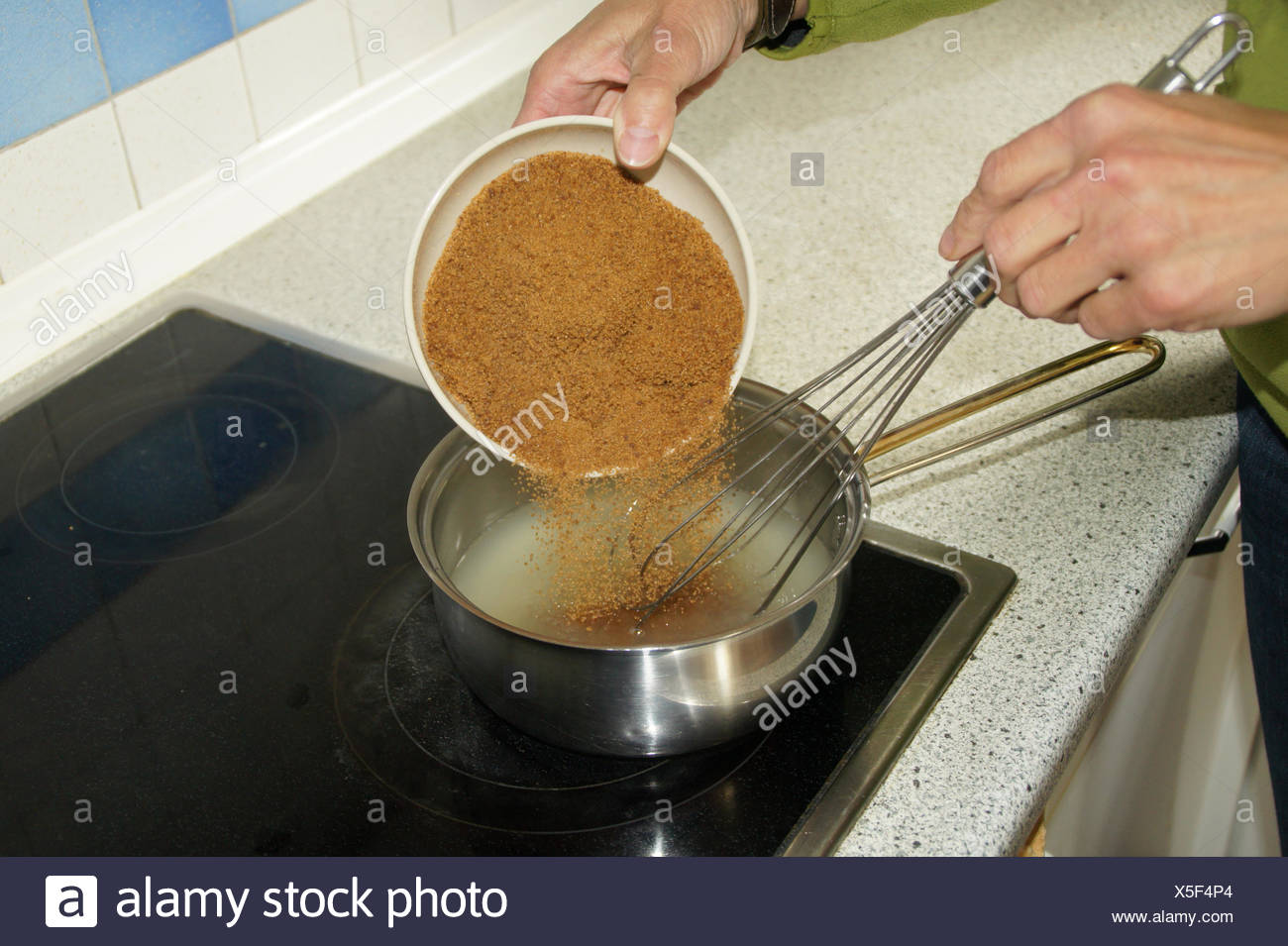 Spruce-jelly preparing, fill in sugar - Stock Image