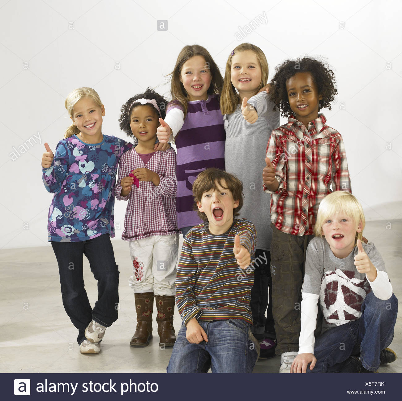 Children, nationality, passed away, laugh, happy, group picture, model released, people, girls, boys, joy, gesture, pollex high, fun, friends, cohesion, multiculturalism, multicultural, cohesion, group, studio, inside, - Stock Image