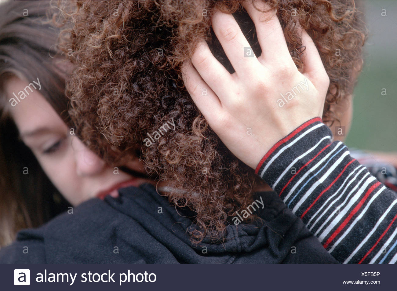 Desperate young women in love with ethnic boy SerieCVS117005 - Stock Image