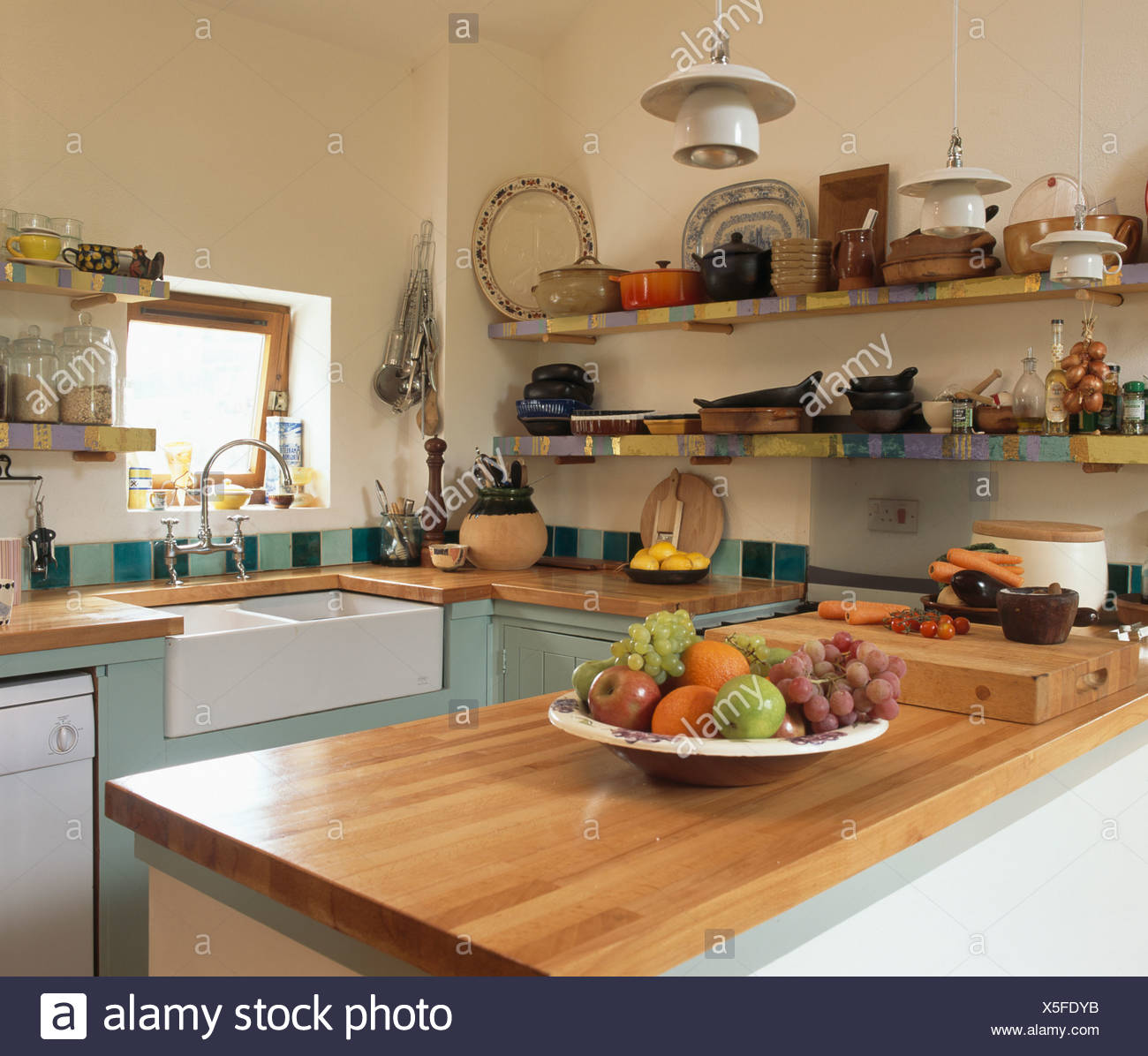 Cherry wood worktop in small country kitchen with Belfast sink and ...