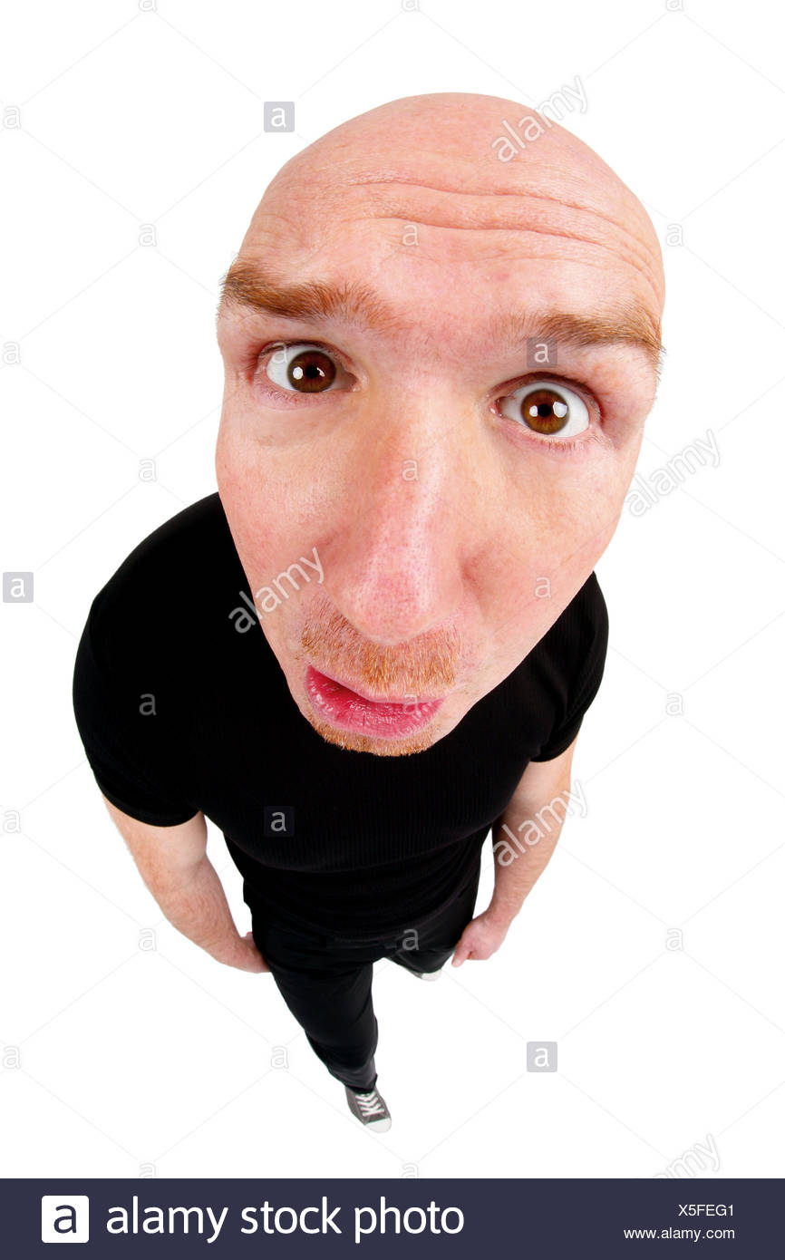 bald headed man looking angry into the camera Stock Photo