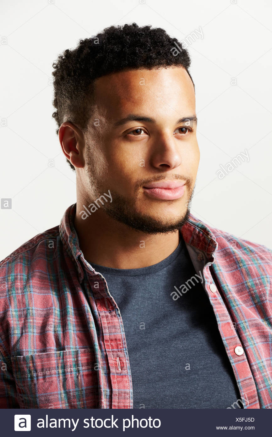 Studio Portrait Of Man Against White Background - Stock Image