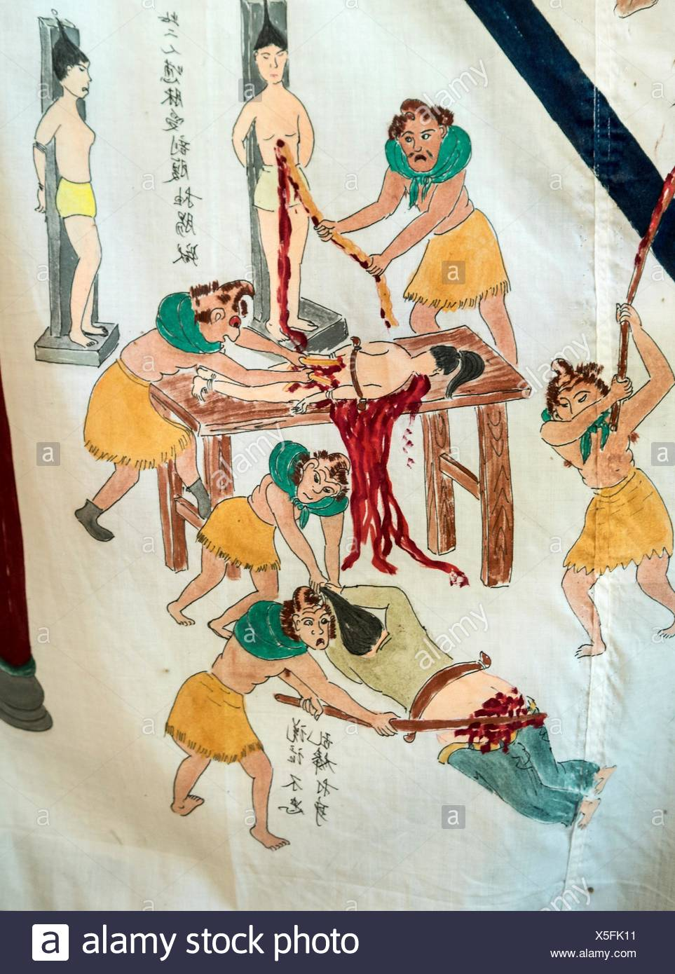 A depiction of cruelty at Duo Gong Temple in Jiu Cheng. - Stock Image
