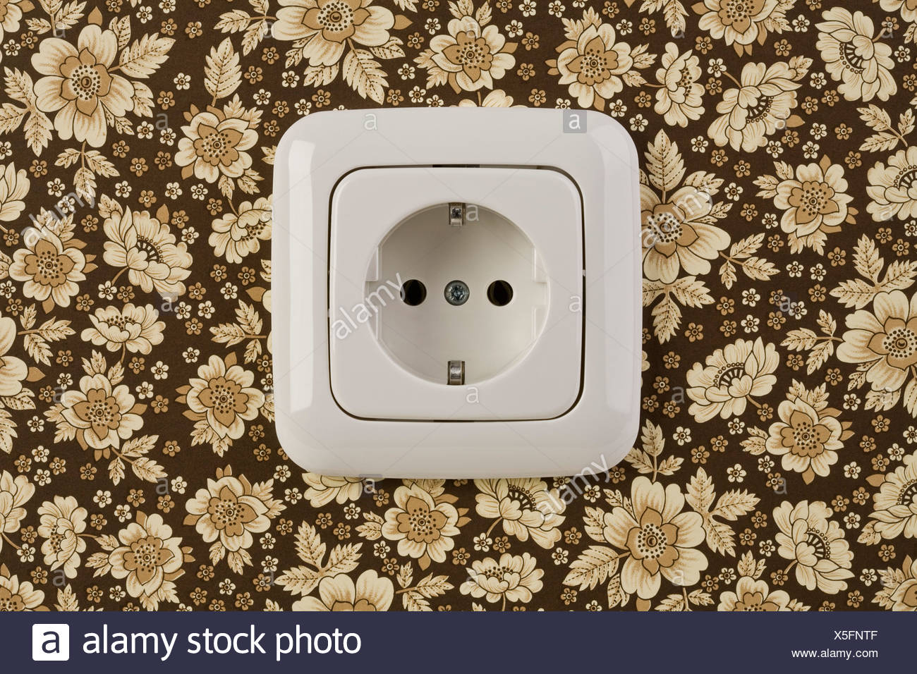 An outlet on wallpaper - Stock Image