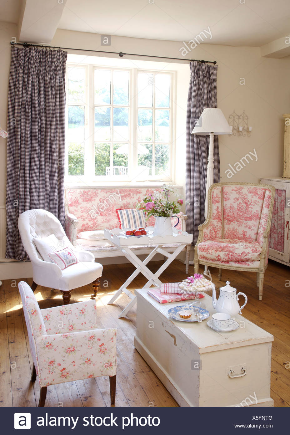 Pink Toile De Joule Chair And Small Sofa In Cottage Living Room With White  Armchair And White Painted Chest