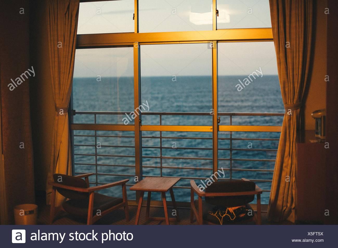 Sea Seen Through Window Of Room - Stock Image