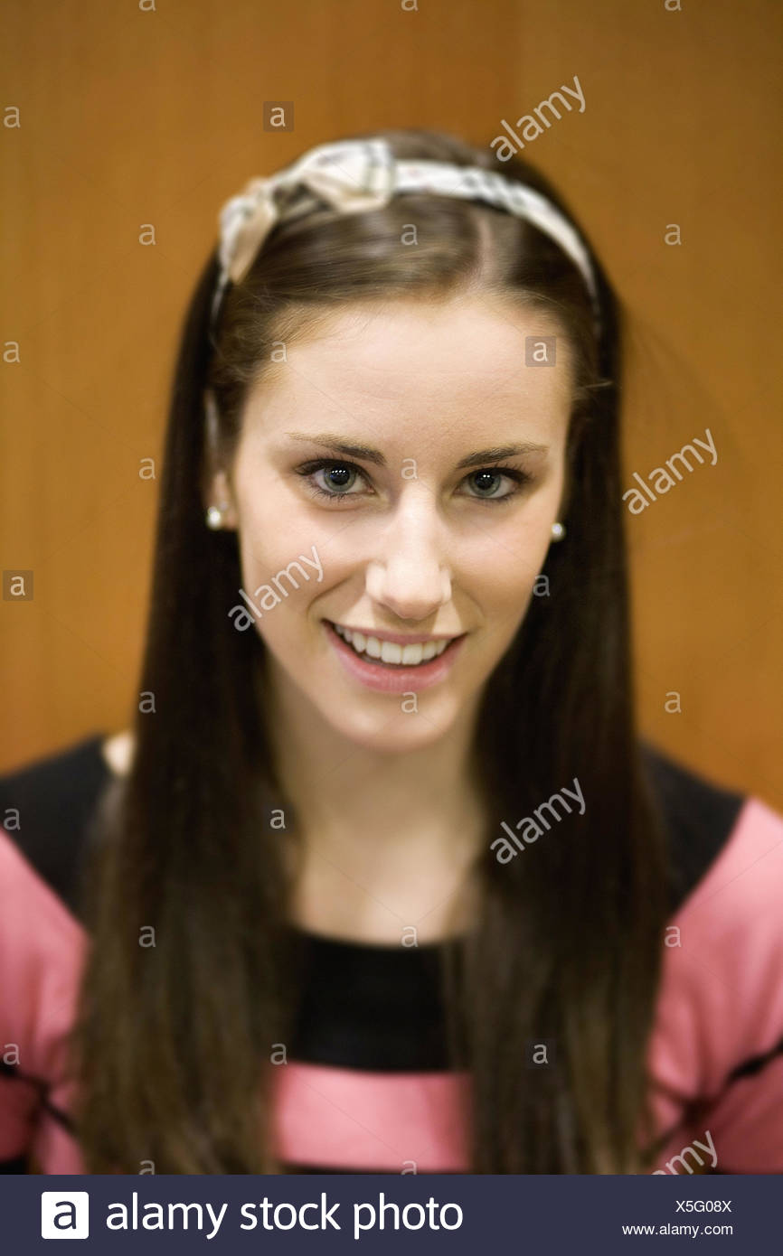 Portrait of a young female college student - Stock Image