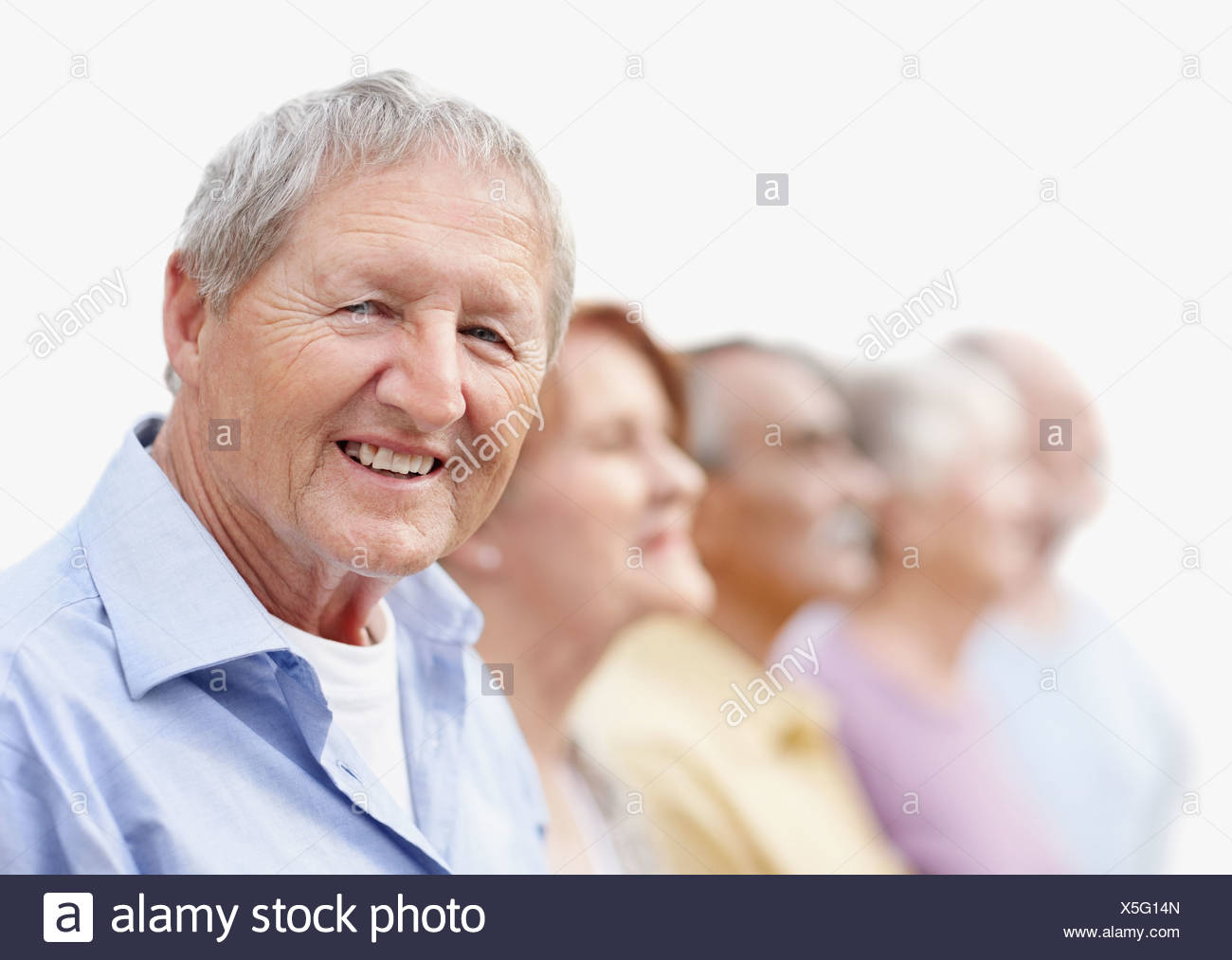 Group of seniors standing in a row - Stock Image