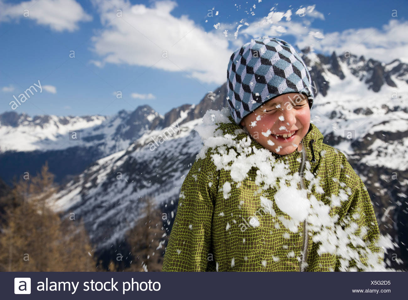 Boy hit by snowball. - Stock Image