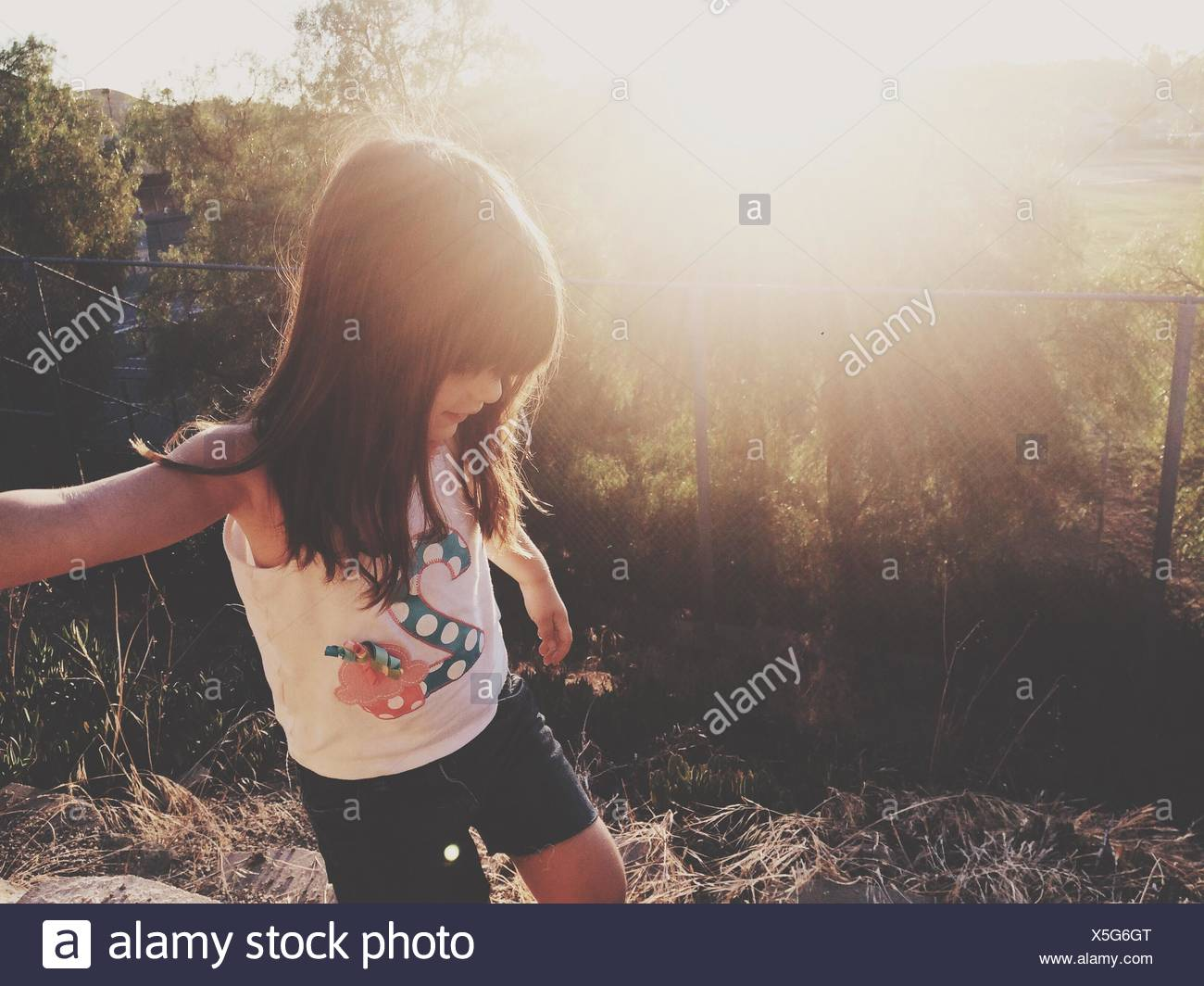Girl Looking Down On Field - Stock Image