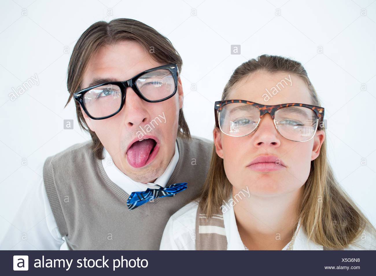 Funny geeky hipsters grimacing - Stock Image
