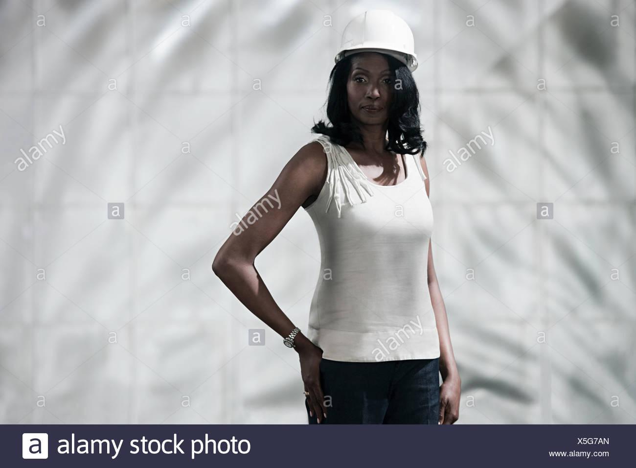 Businesswoman wearing hard hat - Stock Image