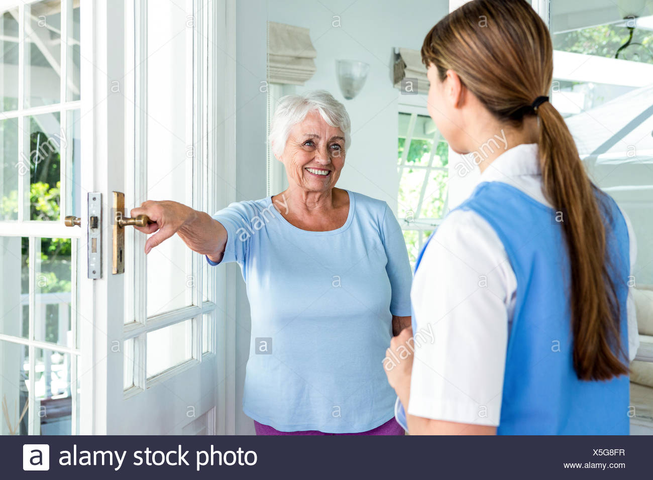 Happy aged woman standing nurse - Stock Image