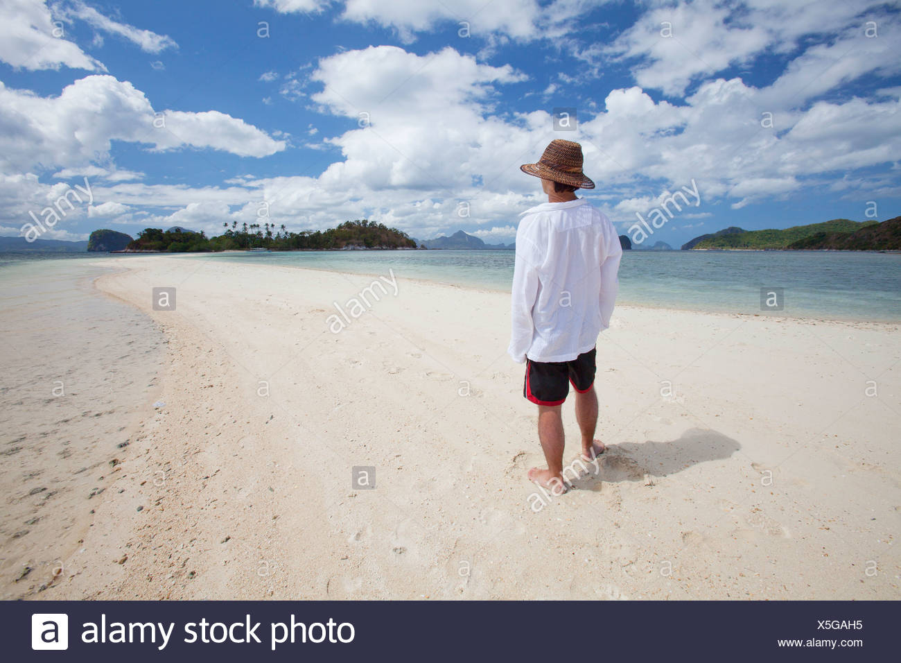 A Tourist Stands On The Pure White Sands Of Snake Island