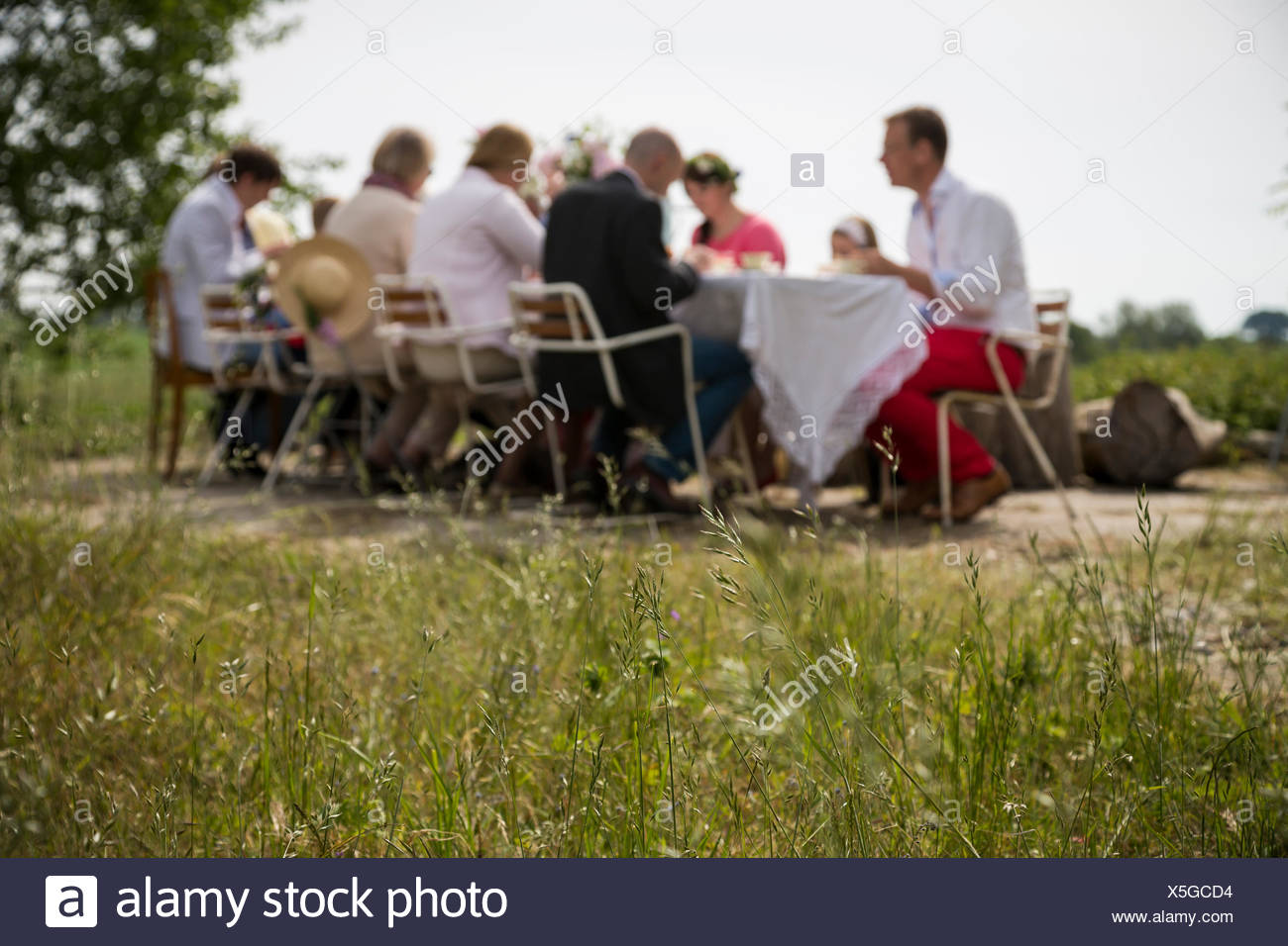 Sweden, Skane, Family with one child (8-9) during midsummer celebrations - Stock Image