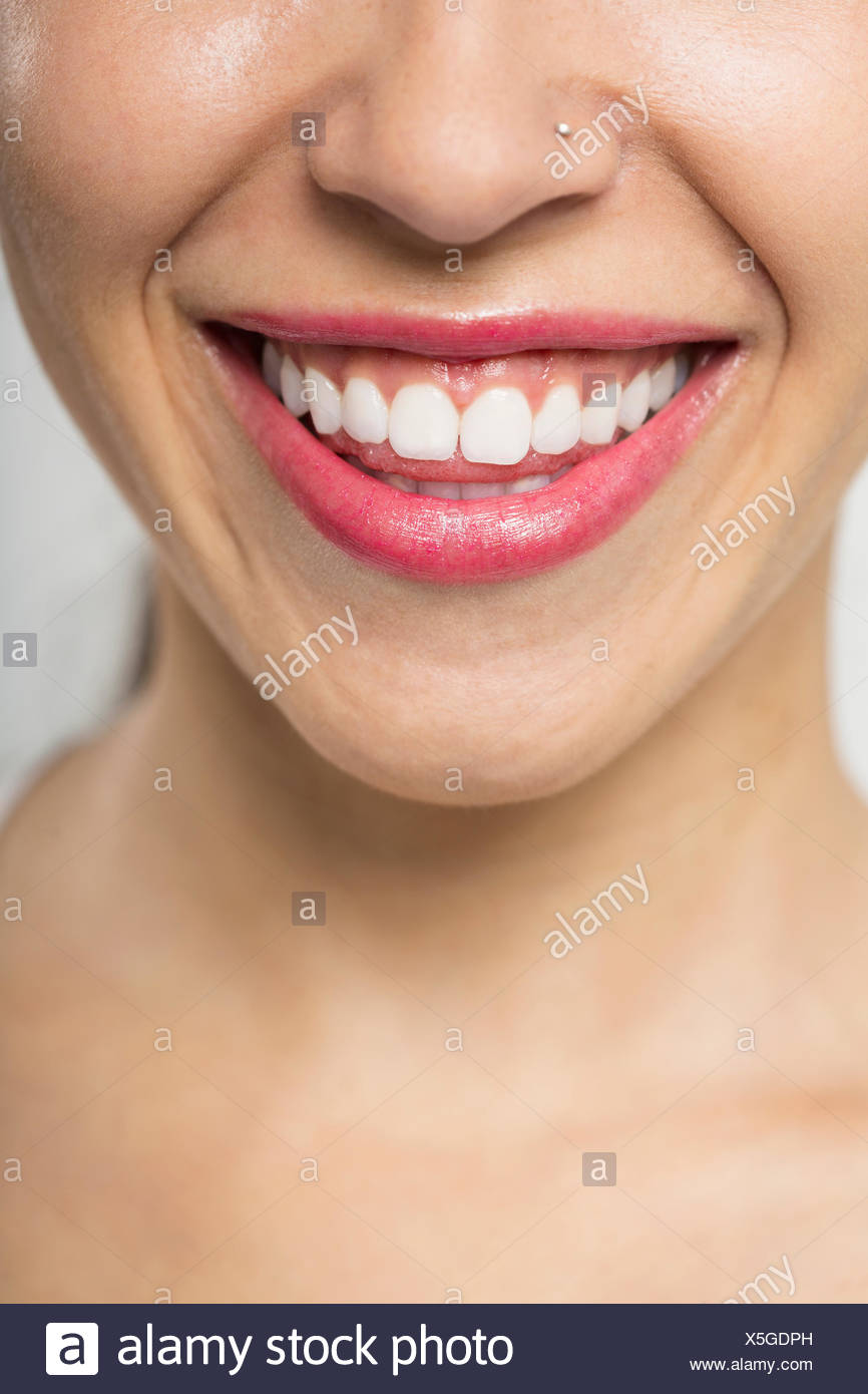 Close up of smiling woman with nose ring - Stock Image