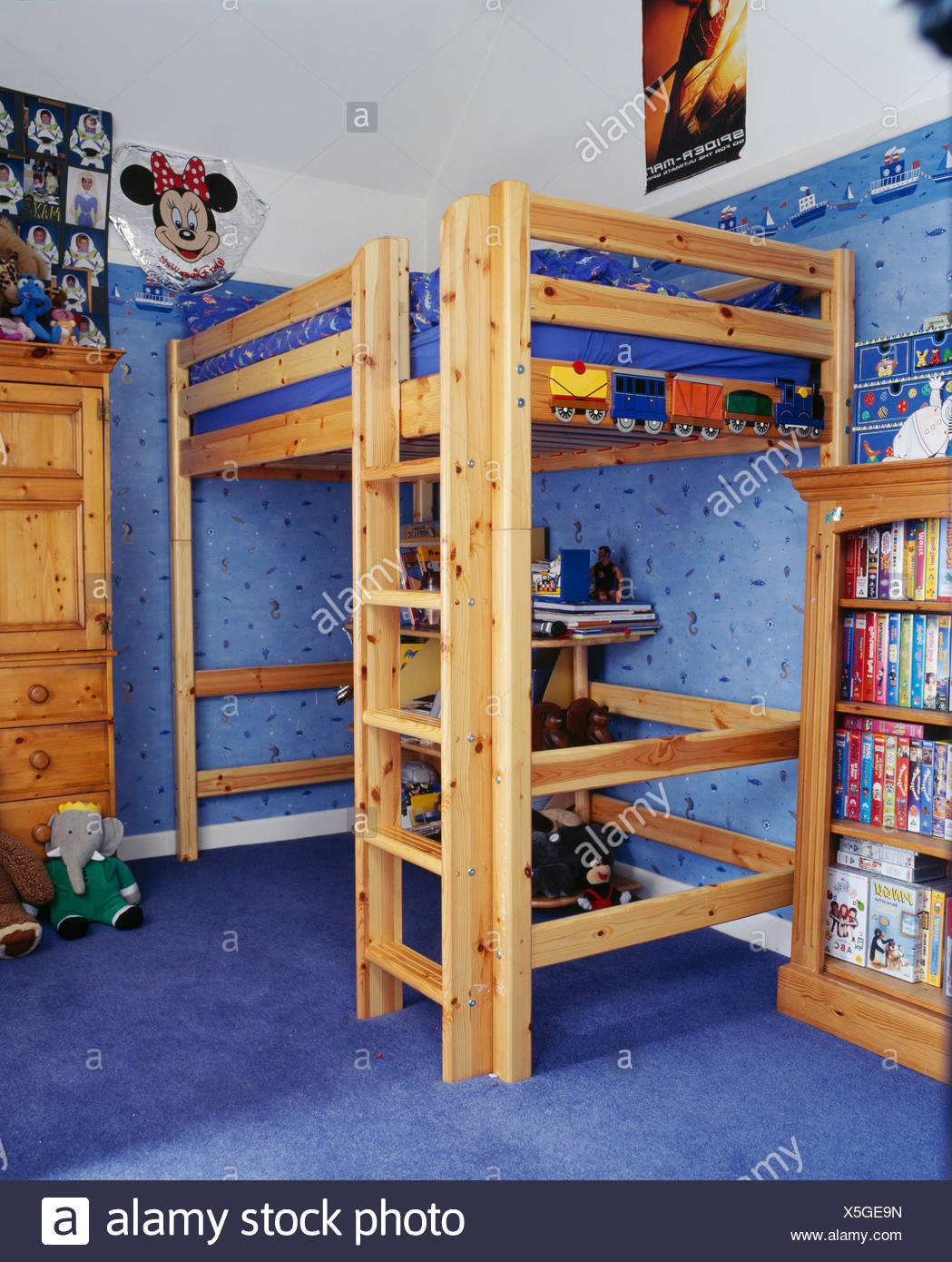 Integral Wooden Ladder To Platform Bed In Child S Bedroom With Blue Wallpaper And Carpet Stock Photo Alamy
