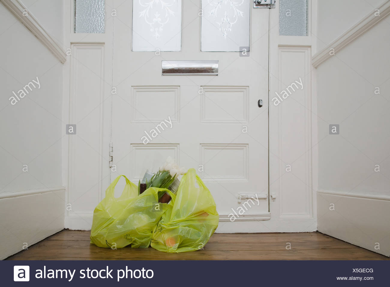 Shopping bags by front door - Stock Image