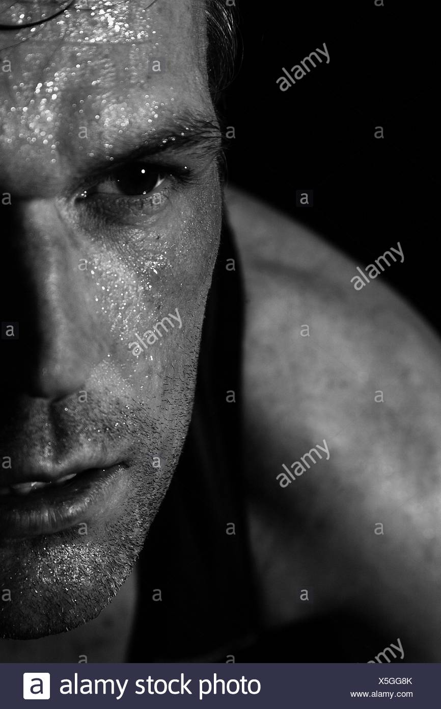 Sweating sportsman, strained, face covered with sweat - Stock Image