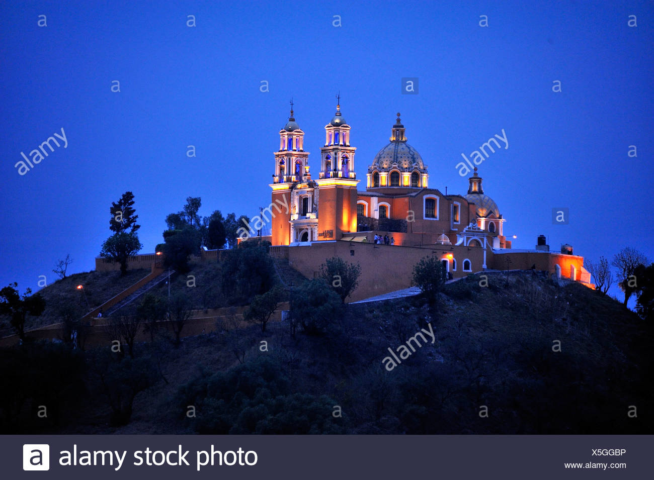 Church of Iglesia Nuestra Senora de los Remedios on the ruins of the pre-Hispanic Pyramid of Cholula at night, , Mexico - Stock Image