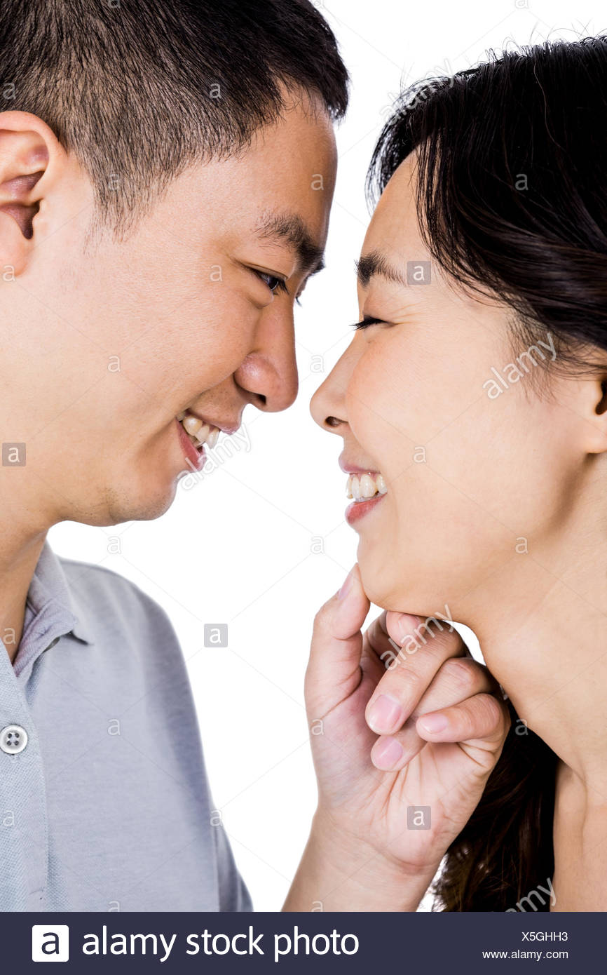 Cheerful man adoring woman - Stock Image