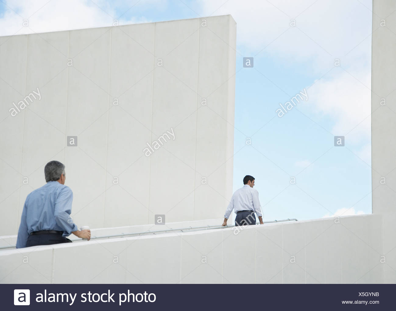 Two businessmen walking up an outdoor staircase Stock Photo