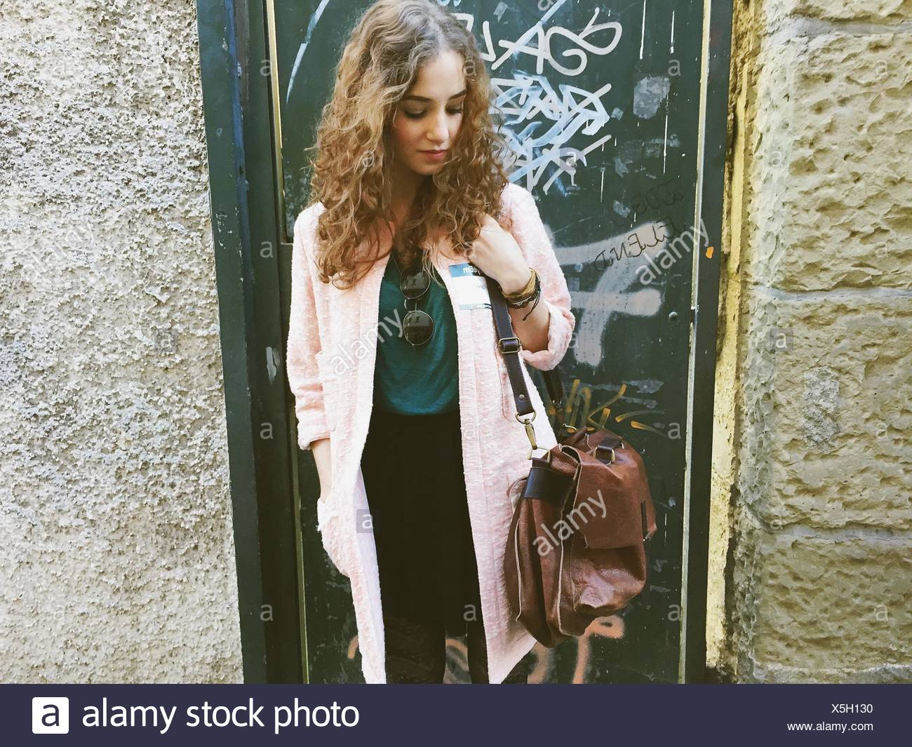 Beautiful Young Woman Standing Outside House - Stock Image