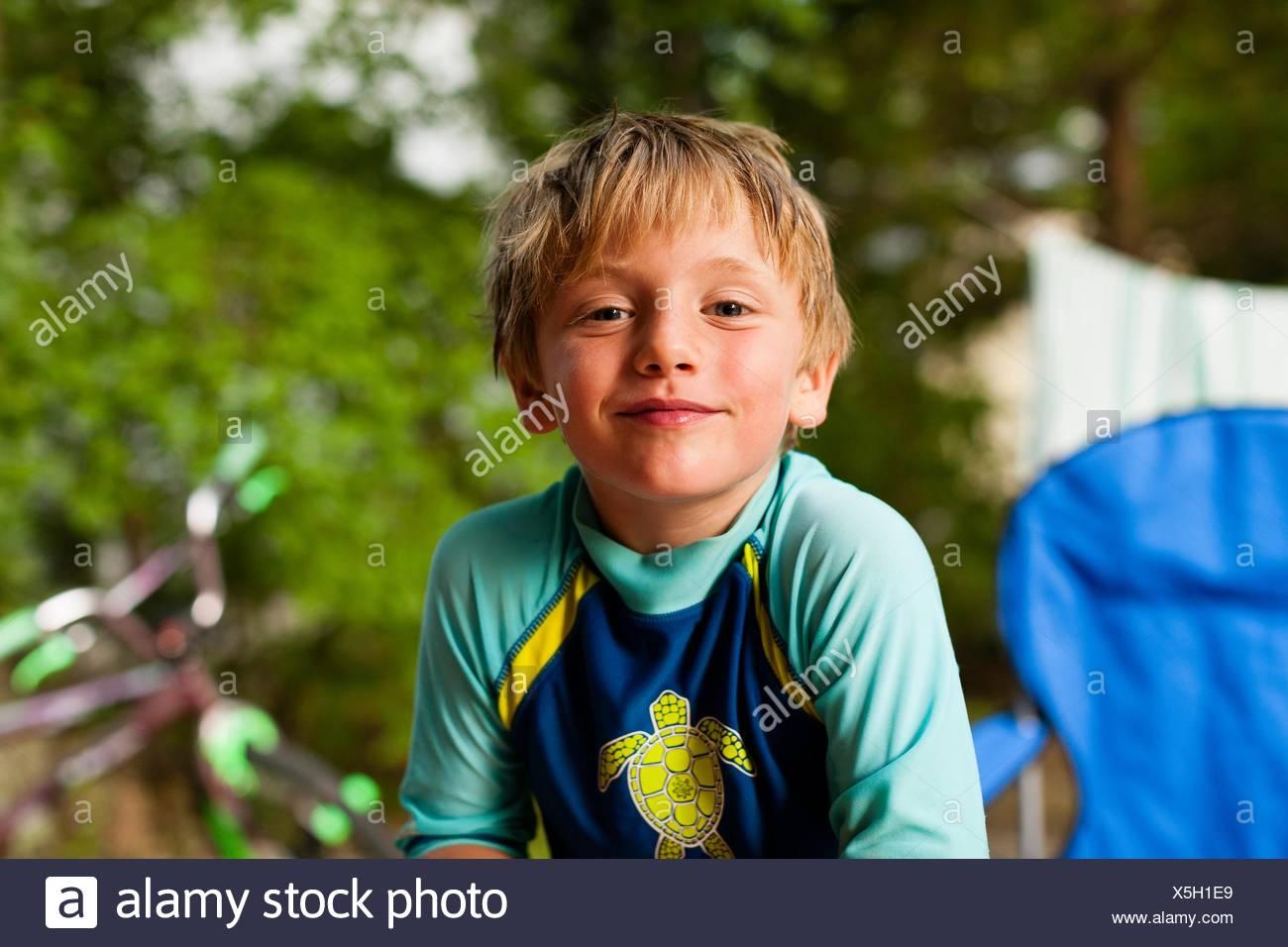 Portrait of boy wearing swimwear looking at camera smiling Stock Photo