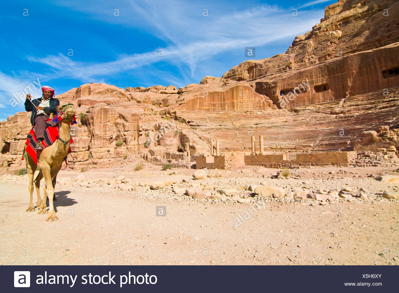Man riding a camel, Petra, Jordan, Middle East Stock Photo