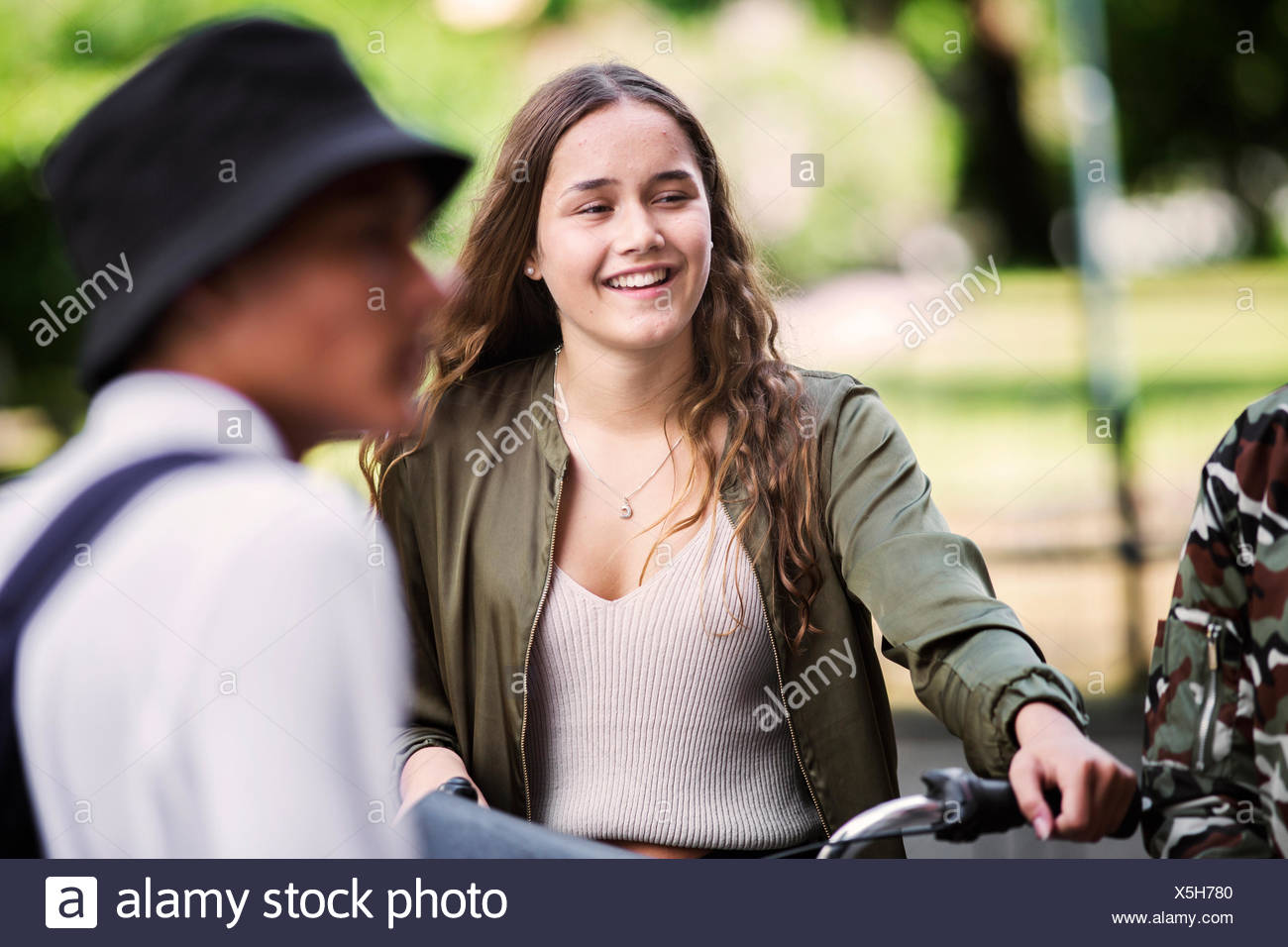 Student (14-15) smiling - Stock Image